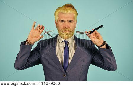 Blond Color. Bleached Hair. Personal Stylist Barber. Bearded Man Hold Razor Scissors. Retro Barbersh