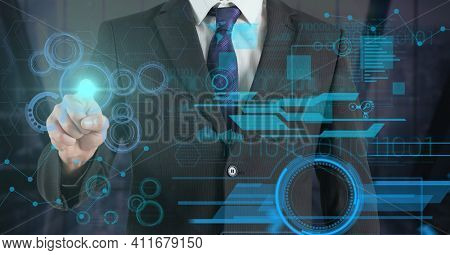 Digital interface with data processing over mid section of businessman touching invisible screen. computer interface and business technology concept