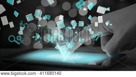 Digital interface with data processing over person using digital tablet against spots of light. global networking and business technology concept