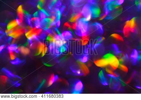 Abstract Bright Colorful Rainbow Blurred Bokeh Background. Unfocused Colored Texture Of Glitter. Blu
