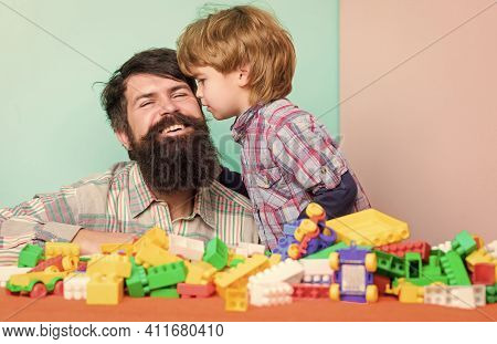 Bearded Hipster And Boy Play Together. Dad And Child Build Of Plastic Blocks. Child Care Concept. Ha