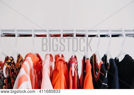 Circular Economy, Second Hand, Fast Fashion, Sustainable Fashion. Many Second Hand Red Colors Clothe