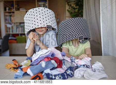 Household Chores For Children. Kids Cleaning Their Room, Sorting Dry Socks And Arranging Them Into P