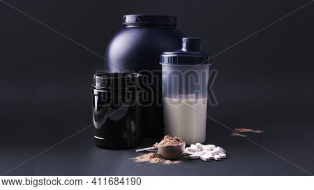 Sports Nutrition Supplements On A Black Background. Fitness, Bodybuilding, Healthy Lifestyle Concept