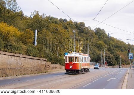 The Old Tram In The Street Of Prague. Quay Of The Vltava River. The Prague Tram Network Is The Third