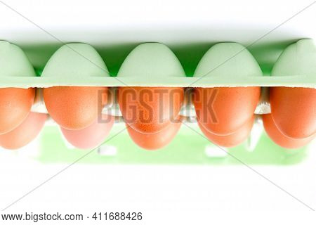 Photo Of Raw Chicken Eggs In Upside Down Egg Box. Food Background.
