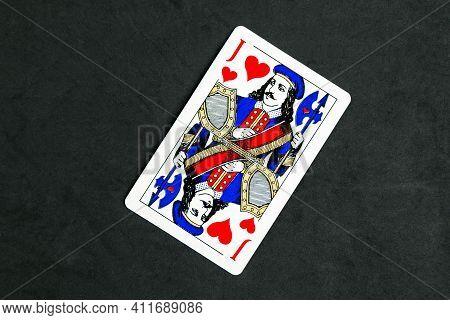 Minsk Belarus - October 1 2020: Joker Of Hearts Playing Card, Black Background