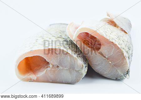 Barramundi Fish Over White Background. Side View.