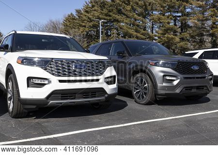 Indianapolis - Circa March 2021: Ford Suv Display At A Dealership. Ford Sells Traditional Gasoline,
