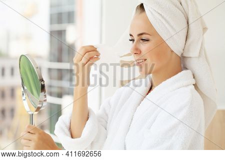 Pretty Girl Wearing Face Care Mask At Home