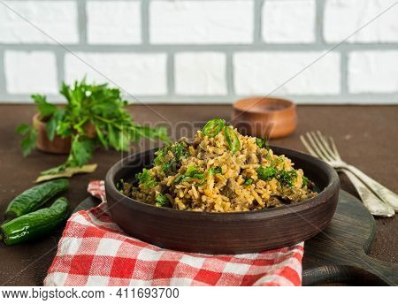Dirty Rice, Cajun Cuisine Dish, Rice With Liver, Minced Pork, Green Pepper And In A Clay Plate On A