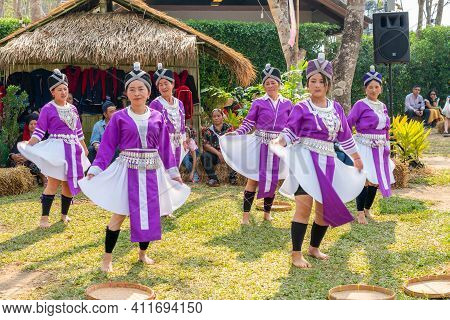 Chiangrai, Thailand - February 16, 2019: Beautiful Hill Tribe Girls In Violet Traditional Costume Da