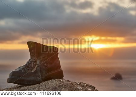 Finisterre Cape Viewpoint At Sunset With Hiker Boot Mark. Pilgrimage