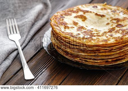 Thin Pancakes On A Plate. Homemade Pancakes, Delicious Food. The Main Product Of Yeast Pancakes, Tra