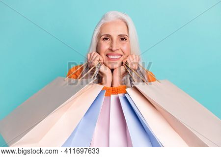 Photo Of Adorable Old Happy Woman Hold Shopping Bags Fists Face Good Mood Discount Isolated On Teal