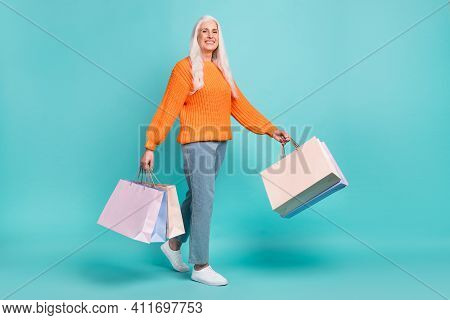 Full Size Profile Side Photo Of Nice Happy Old Woman Hold Shopping Bags Walk Sale Isolated On Teal C