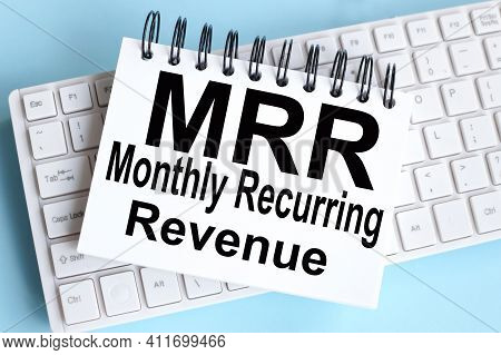Mrr Monthly Recurring Revenue. Text On White Notepad Paper On White Keyboard