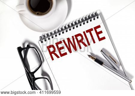 Rewrite. Text On White Notepad Paper On Light Background