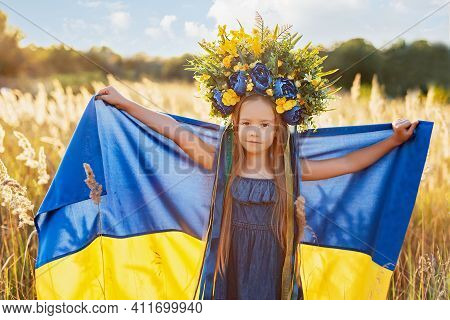 Girl Carries Fluttering Blue And Yellow Flag Of Ukraine In Field. Ukraine's Independence Flag Day. C