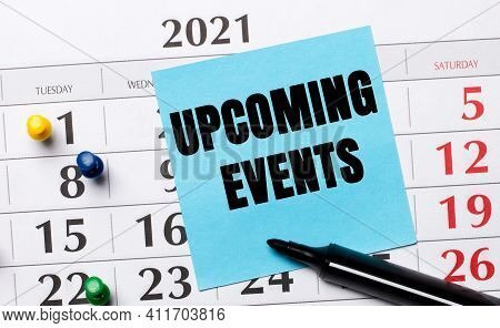 The Calendar Has A Blue Sticker With The Text Upcoming Events And A Black Marker. Organizational Con