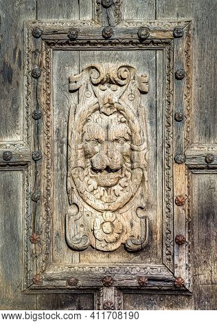 Canterbury, Kent, England - Feb 13 2021: Close Up View Of Detail From The Wooden Door Entrance To Th