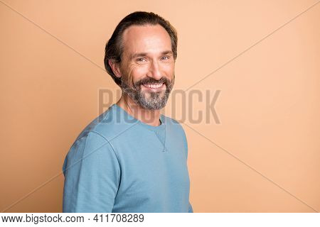 Photo Portrait Of Happy Man Wearing Blue Sweatshirt Smiling Isolated On Pastel Beige Color Backgroun