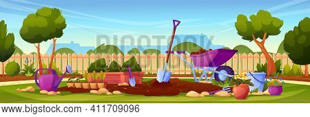Backyard Garden With Cultivated Soil, Shovel And Pitchfork, Watering Can And Wheelbarrow, Fence And
