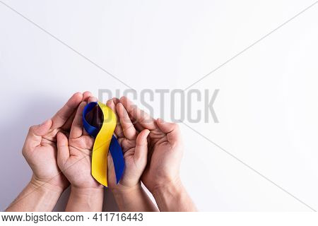 Down Syndrome Day, Man And Woman Hands Holding Blue Yellow Ribbon Awareness Support Patient With Ill