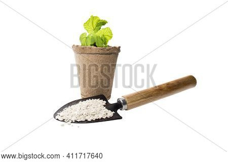 Chemical Plant Growing Fertilizer With Agricultural Tools For Gardening, Isolate On A White Backgrou