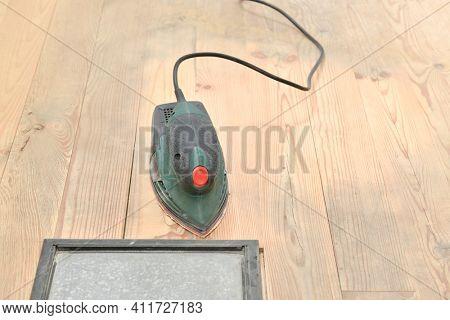 Hardwood floor sanded with electrical sander