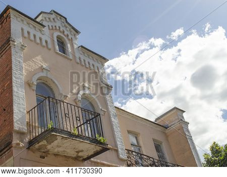 Close Up On Balcony Of An Old European Building Against Blue Sky. Corner Of Beautiful Old Building W