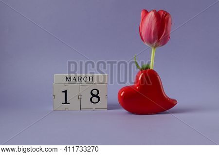 Calendar For March 18: Cubes With The Number 18, The Name Of The Month March In English, A Heart-sha