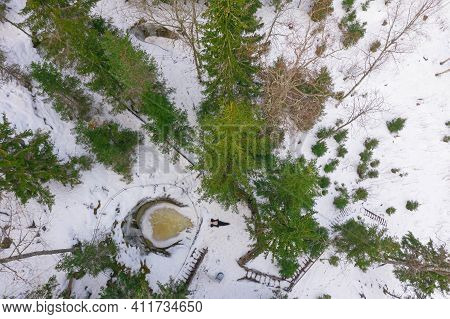 A Woman Admires The Winter Landscape In The Forest. Photo From The Drone. Glacial Potholes In Askol,