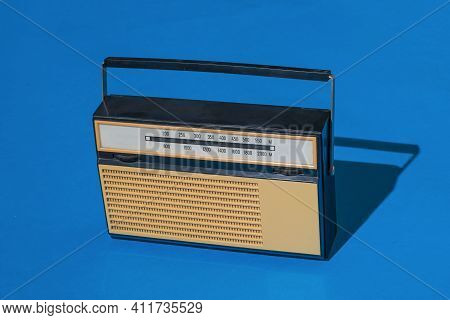 A Receiver For Listening To Radio Broadcasts On A Blue Background. Radio Broadcast Live. Vintage Tec
