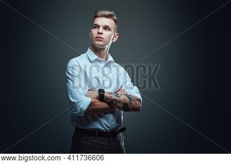 Portrait Of A Isolated In Dark Background Hipster Guy Dressed In Custom Suit. Well Dressed Macho Loo