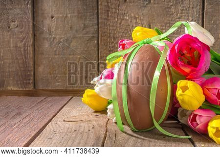 Easter Background With  Big Chocolate Egg