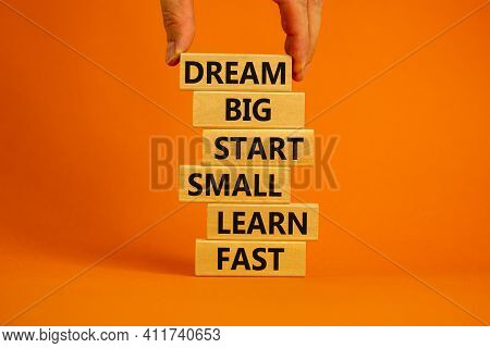 Dream Big Start Small Symbol. Words 'dream Big Start Small Learn Fast' On Wooden Blocks On A Beautif