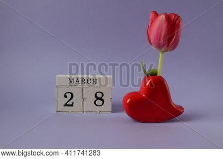 Calendar For March 28: Cubes With The Number 28, The Name Of The Month March In English, A Heart-sha