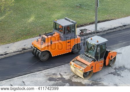 Two Roller Compactor Machines During Operation. Road Renewal Process. Road Construction Working, Asp
