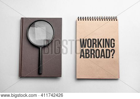Craft Colour Notepad With Text Working Abroad. Notepad With , Magnifying Glass. Business Concept