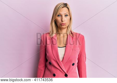 Middle age caucasian woman wearing business jacket depressed and worry for distress, crying angry and afraid. sad expression.