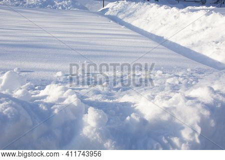 Snow-covered Vegetable Garden In Winter. High Snowdrifts In The Country. Winter Paths In The Garden.