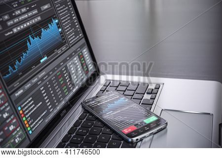 Stock exchange market concept. lLaptop and smartphone with stock trader application, graphs and diagrams on screen. 3d illustration