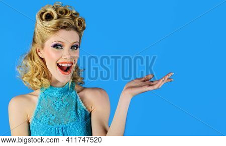 Smiling Woman With Open Hand Palm With Copy Space For Product Or Text. Female Model With Bright Make