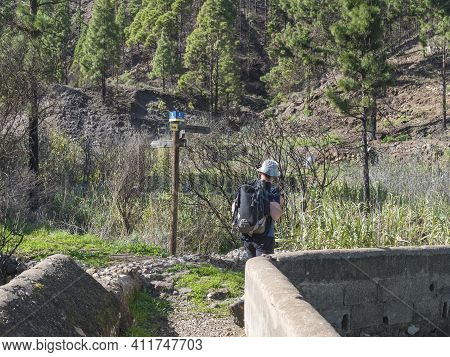 Agaete, Gran Canaria, Canary Islands, Spain December 20, 2020: Man Hiker And Tourist Guide Post At H