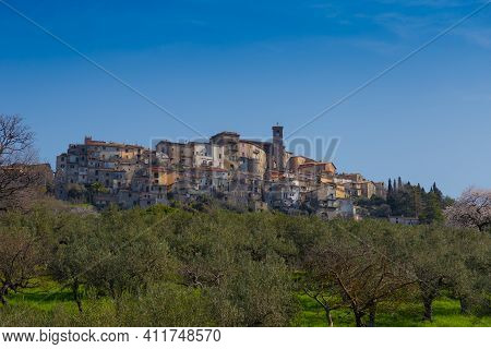 View Of The Town Of Scandriglia In The Province Of Rieti, With The Bell Tower. In The Foreground The