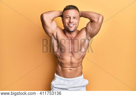 Handsome bodybuldier man posing sexy showing muscle, shirtless torso showing pectorals and sixpack