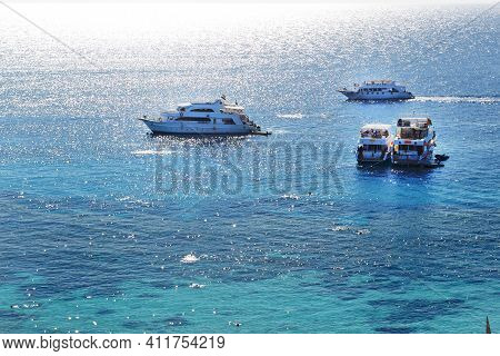 Snorkeling Tourists And Motor Yachts Are On Red Sea, Sharm El Sheikh, Egypt.