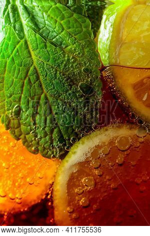 Carbonated Drink With Mint And Lime Slices. Macro Shot.