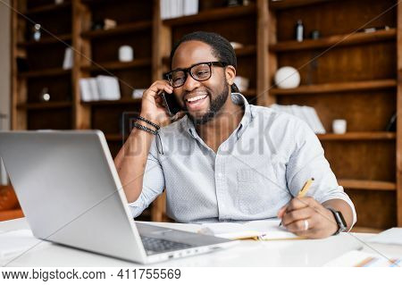 Cheerful African-american Guy Is Doing Multi Tasks Work, A Mixed-race Man Wearing Smart Casual Wear